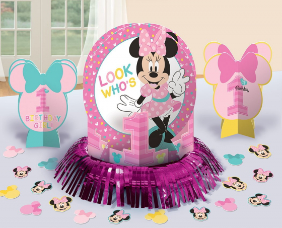 Minnie Fun To Be One Table Decorations Kit Contains: 1 Foil Fringe Centrepiece 12 1/2'(31.7cm). 2 3-D Printed Paper Centrepieces 6 1/2'(16.5cm). 20 Pieces of Paper Confetti 2'(5cm)